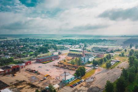 Atmospheric cityscape with a destroyed factory in Belarus. Rainy day with fog. Aerial view