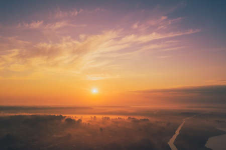Heavenly morning landscape with fog in the fields. Aerial view