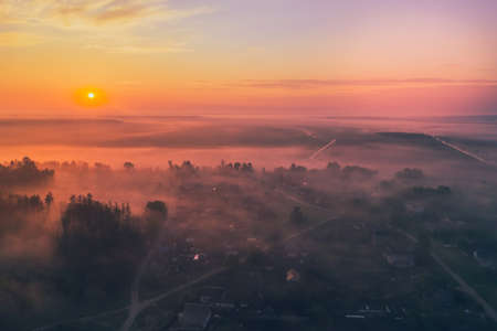 Beautiful morning sunrise with fog forest in Belarus