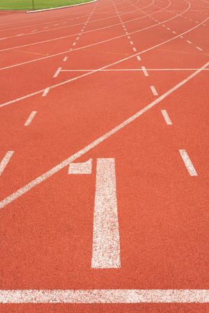 red competition: Running track on sport stadium number one Stock Photo
