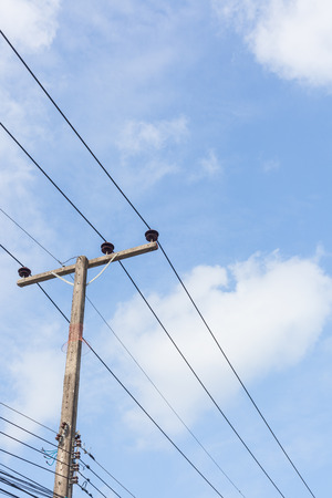 tangling: Electricity post in blue sky at country