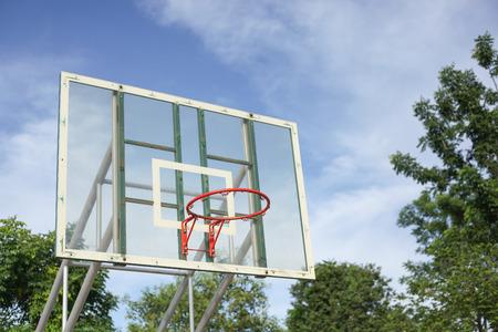 Basketball hoop on blue sky day Stock Photo