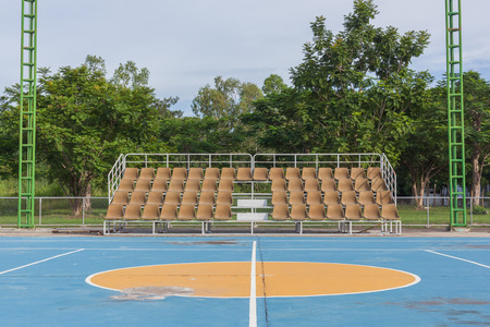 grandstand: Small empty old brown grandstand with seating Foto de archivo