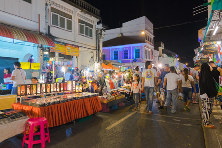 sunday market: Unidentified tourists are shopping at old town night market is called Lard Yai in Phuket, Thailand.
