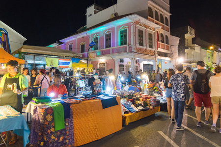 Unidentified tourists are shopping at old town night market is called Lard Yai in Phuket, Thailand.