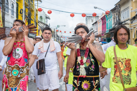 """spiritualist: Phuket, Thailand : - October 5, 2016: A Unidentified devotee of Phuket Vegetarian Festival, person who invites the spirits of gods to possess their bodies call """"Mah Song"""" with pierced weapon to their"""