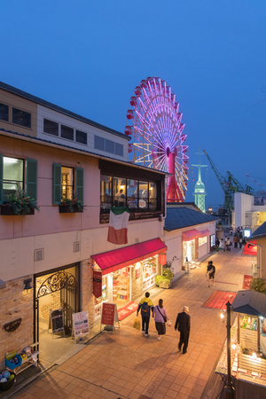 retail scene: Kobe Harborland and ferris wheel in Kobe, Japan
