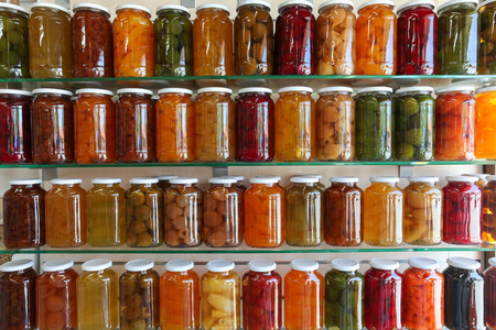 Storage Shelves of Home Canning Fruits and Vegetables 스톡 콘텐츠