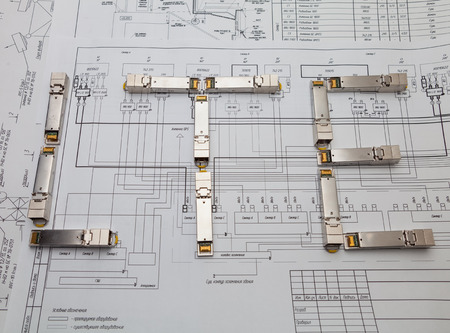Electric gigabit sfp modules for network switch on the blueprint of  communication equipment  are as  LTE title Stock Photo