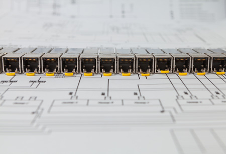 gigabit: Electric gigabit sfp modules for network switch on the blueprint of  communication equipment Stock Photo