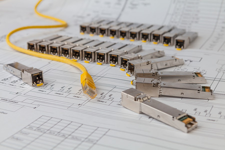 gigabit: Electric gigabit sfp modules for network switch on the blueprint of  communication equipment and patch cord