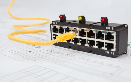 ethernet cable: Network switch and UTP ethernet cable on the blueprint of communication equipment