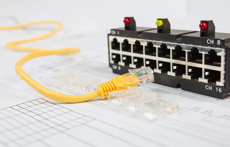 utp: Network switch and UTP ethernet cable on the blueprint of communication equipment