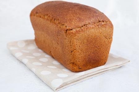 life loaf: Loaf of bread on the napkin