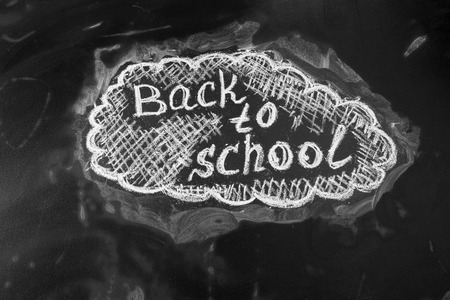 handwrite: Back to school background with title Back to school  written by white chalk on the black chalkboard Stock Photo