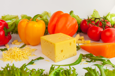 grated cheese: Pieces of cheeses of different tastes, grated cheese, tomatoes, peppers and leaves of frillis and arugula