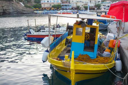 Fishing boat in the small port located in Fish Village Bali on Crete island in Greece. Stock Photo