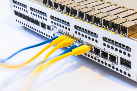 gigabit: Equipment of radio base station, SFP modules, blue and  yellow patch cords. Internet. Communication. Network
