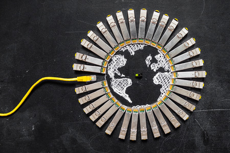 enhancement: Internet SFP network modules  as the shape of Earth and RJ45 ethernet cable for communication and green diode on the black background.Concept of internet securitycomputer data encryption  data protection  security enhancement