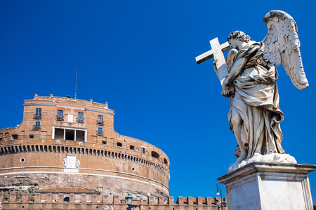 pons: Statue of Angel with the cross and Castel SantAngelo on the background. Ponte SantAngelo, Angelo Bridge, Pons Aelius. Rome. Italy.