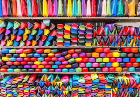 forgery: Colorful handbags, eyeglass cases on the local market (forgery of famous brand). Milan. Italy