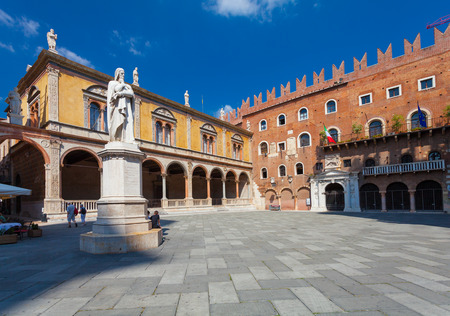 dante alighieri: VERONA, ITALY- September 08, 2016: View on Piazza dei Signori also called Piazza Dante, a medieval square in the old town of Verona and Dante Alighieri monument at the center of Piazza dei Signori.