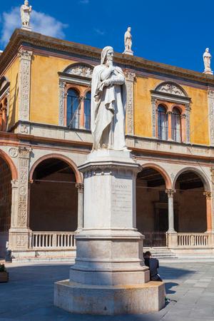 dante alighieri: VERONA, ITALY- September 08, 2016: View on Dante Alighieri monument at the center of Piazza dei Signori.