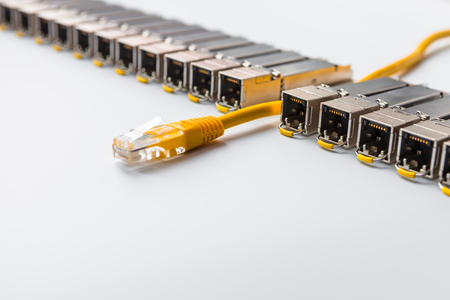 Internet SFP (Small Form-factor Pluggable)  network modules for network switch. Concept of internet communication and connection. SFP is used for both telecommunication and data communications applications