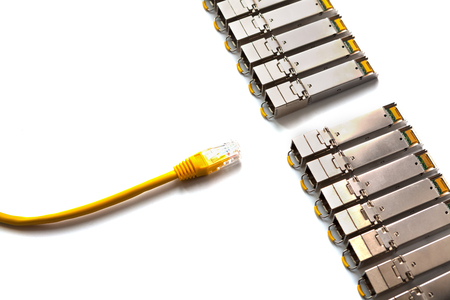 SFP (Small Form-factor Pluggable) and yellow patch-cord with RJ45 for Lan network . Concept of internet communication and connection. SFP is used for both telecommunication and data communications applications