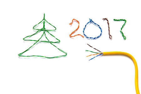 isdn: Christmas tree, number 2017 made from cables of Twisted pair RJ45 and yellow patch cord for Lan network. Concept of New Year, Christmas, internet connection, communication