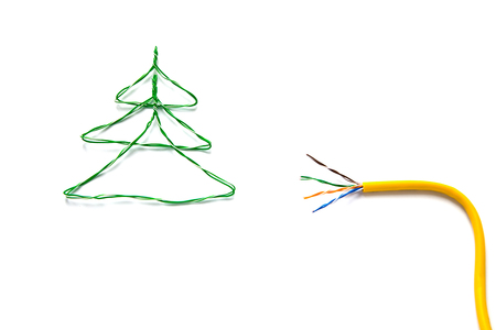isdn: Christmas tree made from cables of Twisted pair RJ45 and yellow patch cord for Lan network. Concept of New Year, Christmas, internet connection, communication