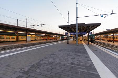 marte: Florence, ITALY- September 10, 2016: Trains TrenItalia of  Regionale type and Regionale Veloce type on the station in Florence Firenze Campo di Marte in the early morning Editorial