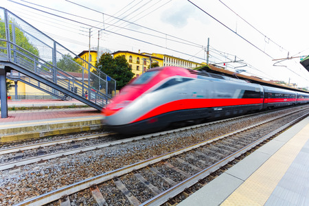 marte: Florence, ITALY- September 10, 2016: Speed train TrenItalia in motion on the station in Florence Firenze Campo di Marte with speed above 200 km per hour