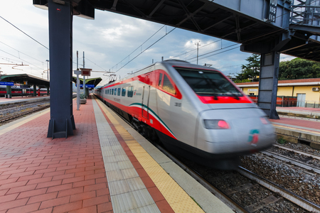 marte: Florence, ITALY- September 10, 2016: Speed train TrenItalia of  Frecciargento type in  motion on the station in Florence Firenze Campo di Marte with speed to 250 km per hour.