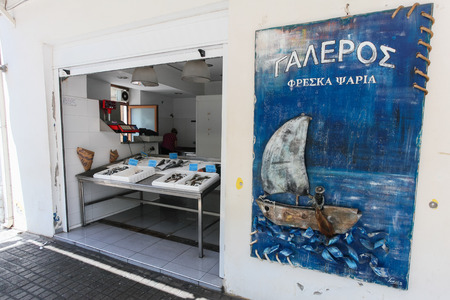 acquirer: Rethymnon, Island Crete, Greece, - June 23: Greek fish store with fresh seafood