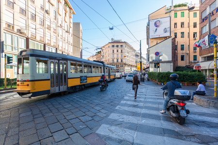 city traffic: MILAN, ITALY - September 06, 2016: The start of  traffic jam with tram, cars and scooters on the Torino street (Via Torino) in the city center in Milan. Editorial