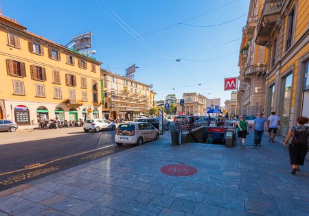 MILAN, ITALY - September 06, 2016: People are walking on the sidewalk near the metro station P.ta Venezia located on the Avenue Buenos Aires (Corso Buenos Aires)