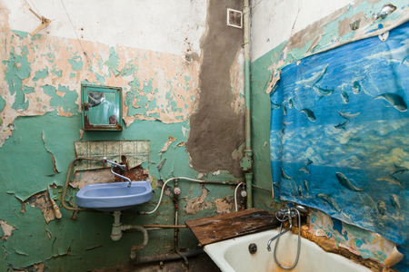 temporarily: Dirty bathroom is in the temporary apartment for living (existence) refugees