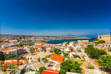 Rethymnon, Island Crete, Greece, - June 23, 2016:Panorama of city Rethymnon and sea of Crete. View from wall of Fortezza Castle