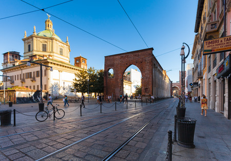 ticinese: MILAN, ITALY - September 12, 2016: View on The Basilica of San Lorenzo Maggiore, San Lorenzo Columns  and the trams railways on the Corso di Porta Ticinese on the summer evening.