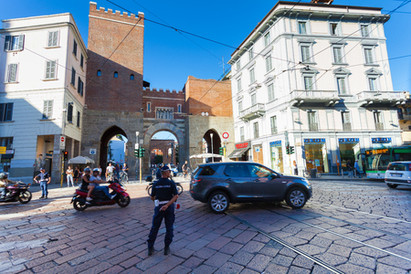 ticinese: MILAN, ITALY - September 12, 2016: Policemen (Polizia Locale) are regulating traffic  near the medieval gate - Porta Ticinese Antica is located on the street Corso di Porta Ticinese Editorial