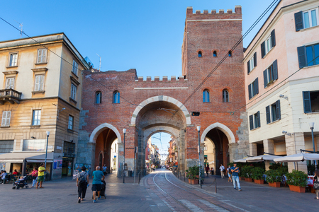 ticinese: MILAN, ITALY - September 12, 2016: Tourists and local people are walking near the medieval gate - Porta Ticinese Antica is located on the street Corso di Porta Ticinese