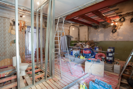 Interior of apartment with materials during on the renovation and construction ( remodel wall from gypsum plasterboard or drywall) Stock Photo