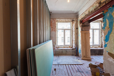 wood floor: View the vintage room with fretwork on the ceiling of the apartment during under renovation, remodeling and construction. ( remodeling of wall from gypsum plasterboard or drywall)