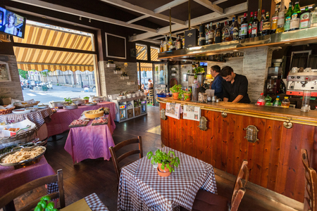 MILAN, ITALY - September 06, 2016: Inside of traditional Italian cafe during  the happy hour time. Happy hour is time in cafe where you can eat italian cuisine without limit for small price.