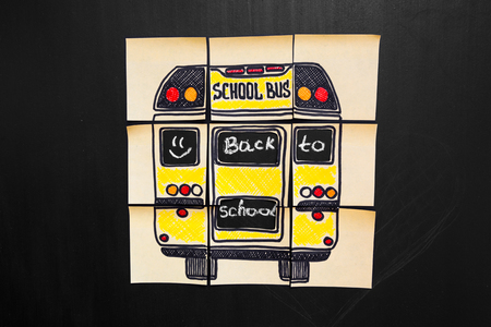 study group: Back to school background with title Back to school and school bus  written on the yellow pieces of paper on the  chalkboard with math formulas written by chalk