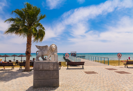LARNACA, CYPRUS - MAY 29, 2014 : View on the Winged Lion statue on the promenade at Foinikoudes, in the south coast town of Larnaca on the Mediterranean island of Cyprus.
