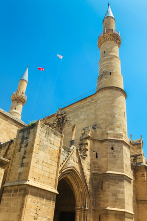 NICOSIA, NORTHERN CYPRUS - MAY 30, 2014: View on The Selimiye mosque (ex. St. Sophia Cathedral) and flags of Turkey and Northern Cyprus Editorial