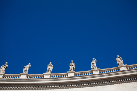 Statues standing on the roof of St. Peters Basilica in  Vatican. Italy
