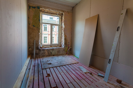 Interior of apartment with materials during on the remodeling, renovation, extension, restoration, reconstruction and construction.(upgrading wall from gypsum plasterboard or drywall and double-glazing window or double glass pane)